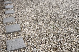 Path from square stones on gravel